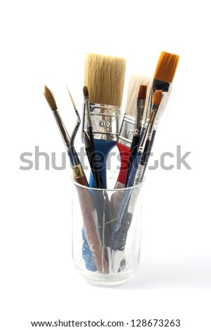 brushes in jar on white background - stock photo
