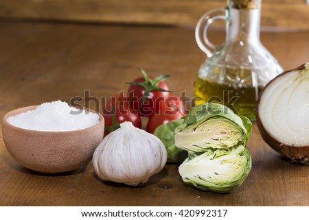 brussel sprouts with tomatoes extra virgin olive oil garlic and salt. ingredients - stock photo