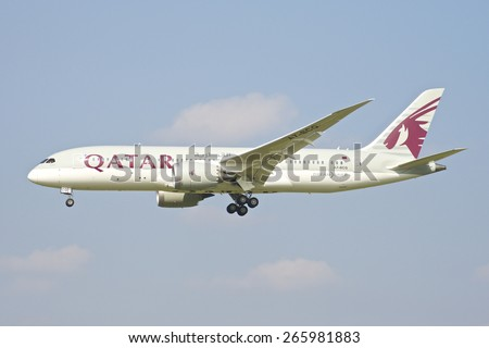 BRUSSELS - APRIL 2: Boeing 787 Dreamliner of Qatar Airways approaching Brussels Airport in Brussels, BELGIUM on APRIL 2, 2015. Qatar Airways, is the state-owned flag carrier of Qatar. - stock photo