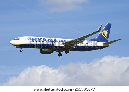 BRUSSELS - APRIL 2: Boeing 737-800 of Ryanair approaching Brussels Airport in Brussels, BELGIUM on APRIL 2, 2015. Ryanair is an Irish low-cost airline headquartered in Swords, Dublin.  - stock photo