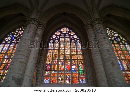 Brussels, Belgium - APR 11 2015: Group of windows decorated with stained glass inside the Cathedral of St Michael and St Gudula  - stock photo