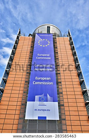 BRUSSELS, BELGIUM-APRIL 27, 2015: The European Commission headquarter the Berlaymont building decorated with EU flag and the Commission title - stock photo