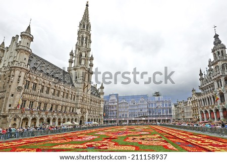 BRUSSELS, BELGIUM - AUGUST 15: Giant carpet made with  flowers within the celebrations of the 50th anniversary of Turkish workers' migration at Grand Place in Brussels, Belgium on August 15, 2014. - stock photo