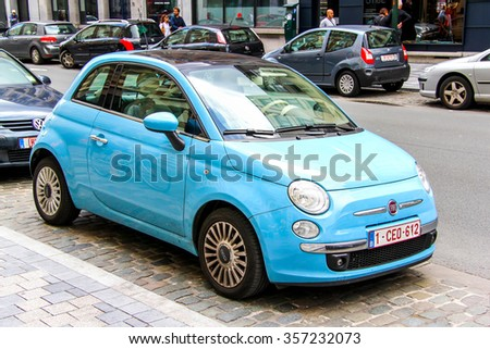 BRUSSELS, BELGIUM - AUGUST 9, 2014: Motor car Fiat 500 in the city street. - stock photo