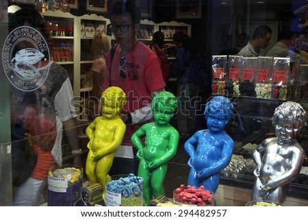 BRUSSELS, BELGIUM - AUGUST 13, 2012: Multicoloured copies of the Manneken Pis in a chocolate shop in Brussels, Belgium. - stock photo
