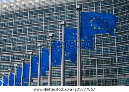 BRUSSELS, BELGIUM - CIRCA MAY 2014. European Flags wave in front of the european comission building, in the european earthquakes, during the european elections week. - stock photo