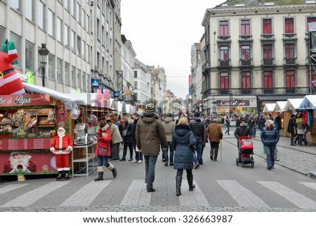 BRUSSELS, BELGIUM-DECEMBER 05, 2014: Christmas Market in center Brussels, very popular between local people and tourists - stock photo