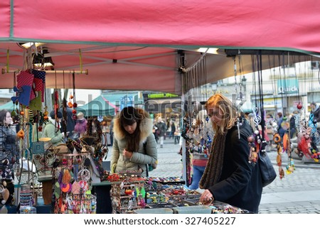 BRUSSELS, BELGIUM-DECEMBER 06, 2014: Christmas Market in center Brussels, very popular between local people and tourists - stock photo