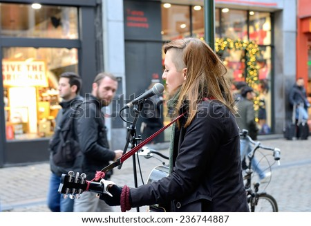 BRUSSELS, BELGIUM-DECEMBER 6, 2014: Street singers in historical center of Brussels are one of the attractions of the old city - stock photo