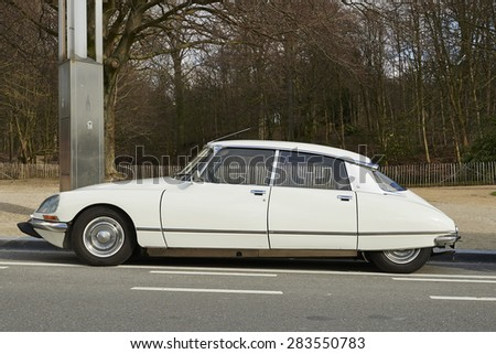 BRUSSELS, BELGIUM - FEBRUARY 16, 2014: A white, 1968 Citroen DS, the classic, elegant, streamlined French automobile, standing in the street in Brussels, Belgium - stock photo