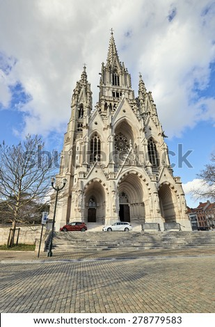 BRUSSELS, BELGIUM-FEBRUARY 16, 2014: Neo-gothic Church Notre-Dame de Laeken in Brussels. Belfry is 99m heigh and highest one in Belgium. In Krypta are members of Royal family buried. - stock photo