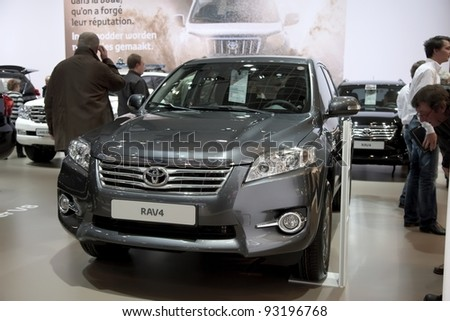 BRUSSELS, BELGIUM - JANUARY 12: Annual autosalon brussel 2012 auto motor show in Heysel expo hall. Toyota RAV4 on display. January 12, 2012 in Brussels,  Belgium - stock photo