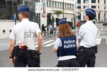 BRUSSELS, BELGIUM - JULY 30, 2014: Flemish Police officers on watch near the Brussels Central Station - stock photo