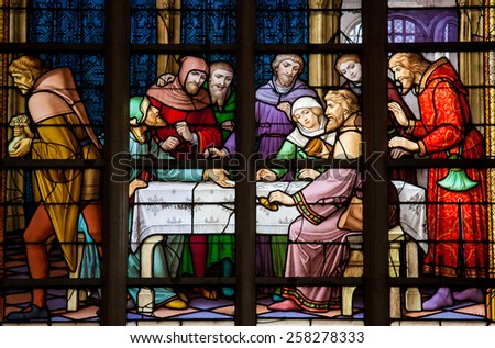 BRUSSELS, BELGIUM - JULY 26, 2012: Stained Glass depicting the local legend of Jews stealing sacramental bread, in the Cathedral of Brussels, Belgium. This antisemitic legend dates back to 1370. - stock photo