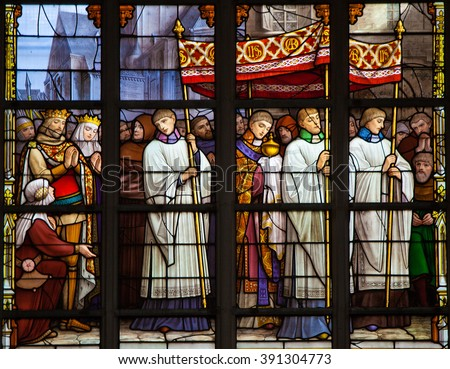 BRUSSELS, BELGIUM - JULY 26, 2012:  Stained glass window depicting a Catholic Procession in the cathedral of Brussels, Belgium. - stock photo
