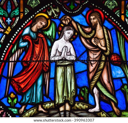 BRUSSELS, BELGIUM - JULY 26, 2012: Stained Glass window of Jesus' baptism in the river Jordan by Saint John the Baptist, in the Cathedral of Brussels, Belgium. - stock photo