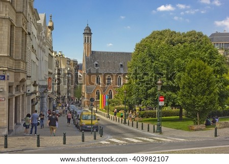 BRUSSELS, BELGIUM - JULY 17, 2014:  Street Rue de la Madeleine leading to church Saint Marie-Madeleine - stock photo