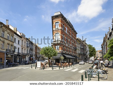 BRUSSELS, BELGIUM - JULY 17, 2014: The old street with the scenic houses, Square du Chatelain in Ixelles is a good place for lunch on July 17 in Brussels. - stock photo