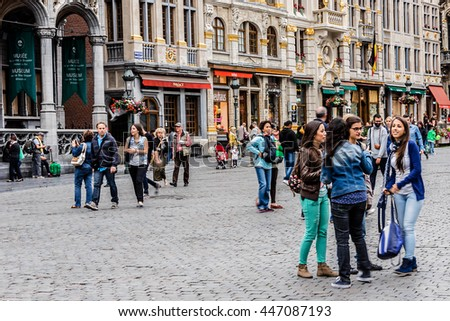 BRUSSELS, BELGIUM - JUNE 19, 2014: Many tourists visiting area of famous Grand Place (Grote Markt) - the central square of Brussels. Grand Place was named by UNESCO as a World Heritage Site in 1998. - stock photo