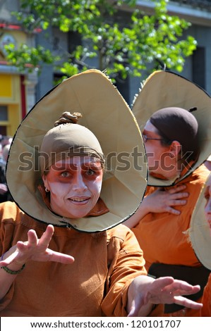 BRUSSELS, BELGIUM-MAY 22: An unidentified participant plays in a composition during Zinneke Parade on May 22, 2010 in Brussels, Belgium.This parade is a biennial free-attendance artistic event. - stock photo