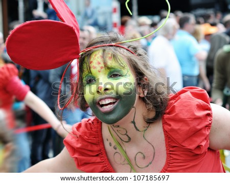 BRUSSELS, BELGIUM-MAY 19: Unidentified participant plays in a composition during Zinneke Parade on May 19, 2012 in Brussels. This parade is a biennial urban artistic and free-attendance event - stock photo