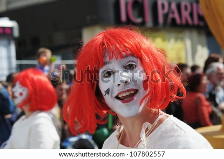 BRUSSELS, BELGIUM-MAY 19: Unidentified participant shows happy personage during Zinneke Parade on May 19, 2012 in Brussels. This parade is a biennial urban artistic and free-attendance event - stock photo