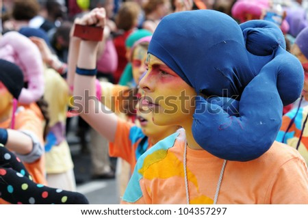 BRUSSELS, BELGIUM-MAY 19: Unknown participant shows his mystic creature costume at Zinneke Parade on May 19, 2012 in Brussels, Belgium. This parade is an artistic biennial urban free-attendance event. - stock photo