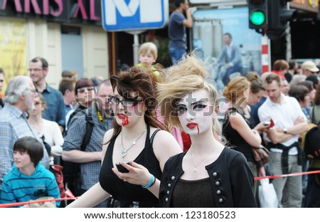 BRUSSELS, BELGIUM-MAY 19: Unknown participants demonstrate their costumes at Zinneke Parade on May 19, 2012 in Brussels. This parade is an artistic biennial urban free-attendance event - stock photo