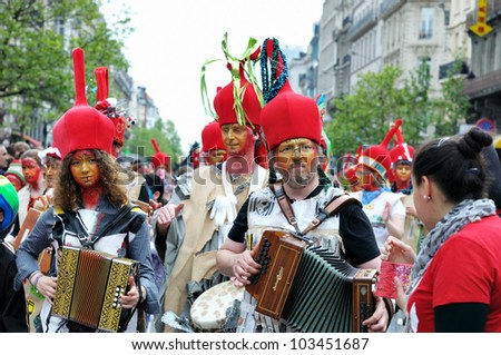 BRUSSELS, BELGIUM-MAY 19: Unknown participants in fancy dresses play music during Zinneke Parade on May 19, 2012 in Brussels. This parade is a biennial urban artistic and free-attendance event. - stock photo