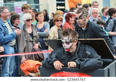 BRUSSELS, BELGIUM-MAY 19: unknown participants play role in procession at Zinneke Parade on May 19, 2012 in Brussels. This parade is an artistic biennial urban free-attendance event. - stock photo