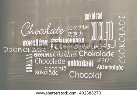 BRUSSELS, BELGIUM - NOVEMBER, 11, 2012: Store window in Brussels with the word chocolate in various languages. Belgium is famous for its chocolate, attracting people from all over the world.   - stock photo