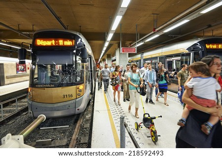 BRUSSELS, BELGIUM - SEPTEMBER 20, 2014: Crowded of people walking in metro Rogier station for transfer in Brussels, Belgium during a summer saturday.  20 September 2014 in Brussels. - stock photo