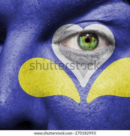 Brussels-Capital Region flag painted on a man's face - stock photo