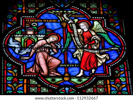 BRUSSELS - JULY 26: Stained glass window depicts the prophet Daniel in the cathedral of Brussels on July, 26, 2012. - stock photo