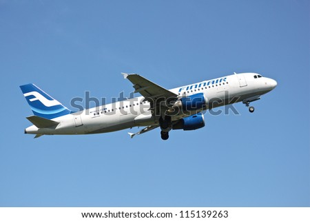 BRUSSELS - MAY 25: Airbus A320-200 of Finnair approaching Brussels Airport in Brussels, BELGIUM on May 25, 2012. Finnair is the flag carrier and largest airline of Finland. - stock photo