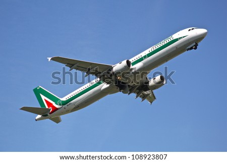 BRUSSELS - MAY 25: An Alitalia Airbus A321-112 approaching Brussels Airport in Brussels, BELGIUM on May 25, 2012. AlItalia is a flag carrier airline of Italy and one of the biggest airlines in Europe. - stock photo