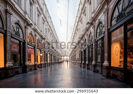 BRUSSELS - May 20: Royal Galleries of Saint-Hubert on May 20, 2015 in Brussels. Opened in 1847, it is one of the oldest shopping galleries in Europe. - stock photo