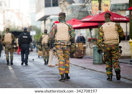 BRUSSELS - NOVEMBER 23: Belgium Army and police at De Brouckere, the central avenue of Brussels, due to security lock-down following terrorist threats on November 23, 2015 in Brussels, Belgium.  - stock photo
