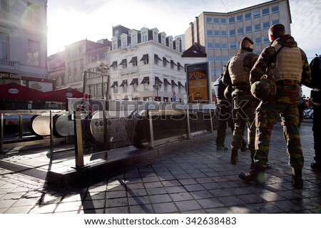 BRUSSELS - NOVEMBER 23: Belgium Army and police at Louise metro station in Brussels as part of security lock-down following terrorist threats. on November 23, 2015 in Brussels, Belgium.  - stock photo