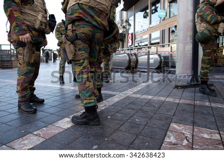 BRUSSELS - NOVEMBER 23: Belgium Army and police at Porte de Namur metro station in Brussels as part of security lock-down following terrorist threats. on November 23, 2015 in Brussels, Belgium.  - stock photo