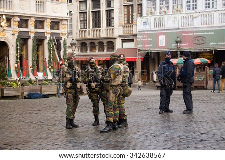 BRUSSELS - NOVEMBER 23: Belgium Army and police in Grand Place, the central square of Brussels part of security lock-down following terrorist threats. on November 23, 2015 in Brussels, Belgium.  - stock photo