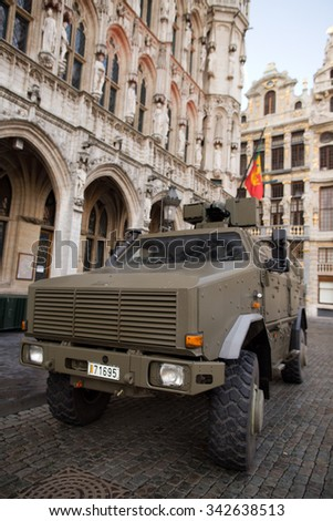 BRUSSELS - NOVEMBER 23: Belgium Army armored vehicle in Grand Place, the central square of Brussels due to security lock-down following terrorist threats. on November 23, 2015 in Brussels, Belgium.  - stock photo
