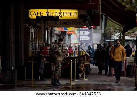 BRUSSELS - NOVEMBER 21: Belgium Army in front of Metropole Hotel in city center on November 21, 2015 in Brussels, Belgium. Brussels is on full security alert. - stock photo