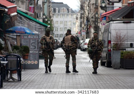 BRUSSELS - NOVEMBER 22: Belgium Army patrolling on a street near Avenue Louise in the city center of Brussels on November 22, 2015 in Brussels, Belgium.  - stock photo