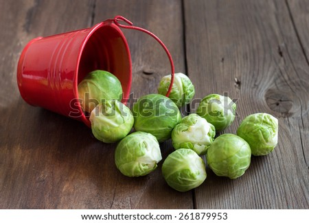 Brussels sprouts in a bucket on an old wooden table - stock photo