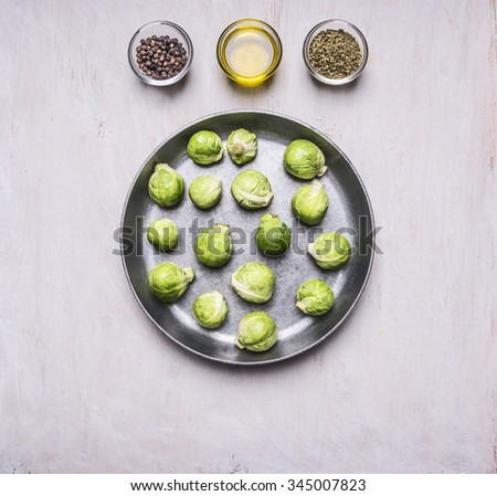 Brussels sprouts in a pan with butter and seasonings healthy foods, cooking and vegetarian concept on wooden rustic background top view close up - stock photo