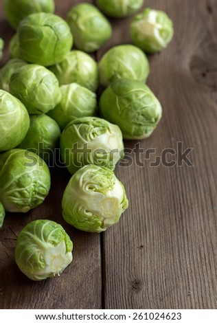 Brussels sprouts on an old wooden table border - stock photo