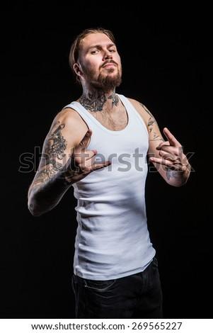 brutal tattooed guy, emotional - stock photo