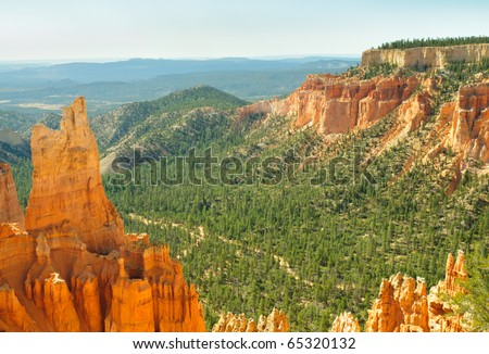 Bryce Canyon orange hoodoo rock formations and green pine forest - stock photo