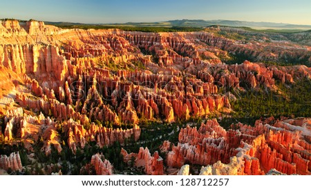 Bryce Canyon, Utah, at Sunrise taken from Inspiration Point showing the vast array of hoodoos. - stock photo